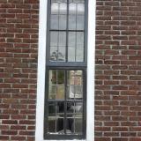 Oude kozijnen met glas in lood ramen